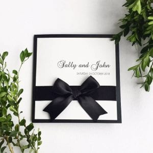 Classic bow black and white wedding invitation